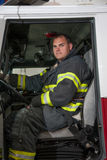 Fire Truck Driver Sitting in Fire Truck Royalty Free Stock Photo