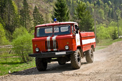 Fire truck driving on country road. Ukraine, Lviv region, village Tukhlya Stock Image