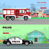 Fire Truck Driving to the and Police Car. Fire truck driving on way to burning houses on background. Red six-wheeled transport in city on road. Police car near Stock Photos