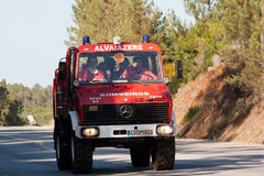 Fire Truck en route to a Wildfire. POMBAL, PORTUGAL - JULY 15: Fire Truck en route to a Wildfire, in Pombal, Portugal on July 15, 2012 Royalty Free Stock Photography