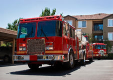 Fire Truck and Engine. Department fire truck and engine show up on scene Royalty Free Stock Photo