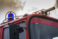 Fire truck fighting with fire. Royalty Free Stock Images