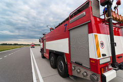 Fire truck or fire-engine on the road. back view Stock Photography