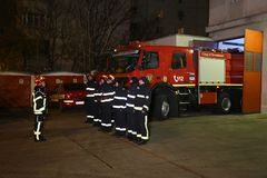 Fire truck firemen ready for action Stock Image