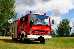Fire truck. On a football field Royalty Free Stock Photo
