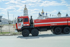 Fire truck goes to a call near Tobolsk Kremlin Royalty Free Stock Photography