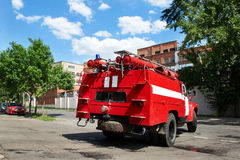 Fire truck goes to an urgent call on street. Red fire truck goes to the an urgent call on the city street Royalty Free Stock Photo