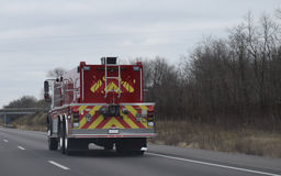 Fire Truck On Highway With Flame Design Stock Photo