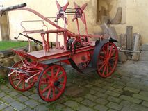 Old fire truck. Historical Fire mechanism to fight fire. The mechanism is almost entirely of wood.Nice the rover. Nice handicraft work royalty free stock photography