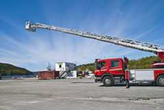 Fire truck (ladder car). Halden fire department checks and maintains the ladders on the fire truck at the Halden port Royalty Free Stock Photo