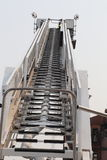 Fire truck ladder- climb to the top for sucess or call 911 Stock Image