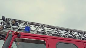 Fire truck ladder detailed close up. Panning view of firefighter truck stock footage