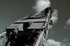 Fire Truck Ladder into Steel Gray Sky Royalty Free Stock Image