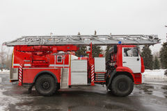 Fire truck with ladders and hoses - big red Russian fire fighting vehicle Stock Photo