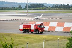 Fire truck on landing lane airport stock photo