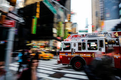 Fire truck in NYC. Fire truck in an emergency situation trough the streets of Times Square, New York city Stock Photography