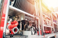 Fire truck open side hatch, hydrant and extinguishing hoses stock photos