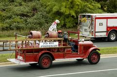 Fire Truck Parade 1. An antique fire department vehicle being driven in a fire muster parade Stock Image