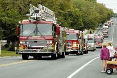Fire Truck Parade 8. Fire and rescue vehicles being driven in a fire muster parade Royalty Free Stock Image