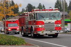 Fire Truck and Paramedics. This is a modern Fire Truck and a Paramedics vehicle en route possibly back to the station as no lights or sirens were on royalty free stock images