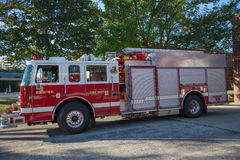 Fire Truck Parked Outside Firefighter Station. Ready to serve Stock Photo