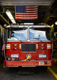 Fire truck. A red fire truck parked in a garage Stock Photo