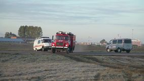 Fire truck rides on the field. On airport stock footage