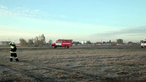 Fire truck rides on the field. On airport stock video footage