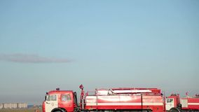 Fire truck rides on the field stock footage