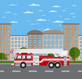 Fire truck on road in urban landscape Royalty Free Stock Images