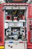 Close up of a fire truck equipment. Close up of the backside of a fire truck with the roller shutter open stock image