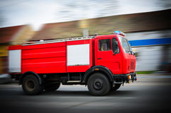 Fire Truck in situation with flashing lights, blurred motion Stock Images