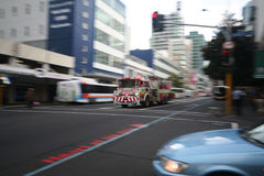 Fire truck speeding. In Auckland street, passing at red light Stock Image