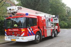 Fire truck is stand-by during a storm, Netherlands