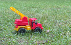 A fire truck toy in the grass. royalty free stock images