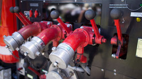 Fire truck valves Stock Photos