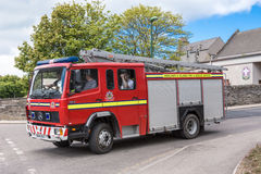 The fire truck of Wick, Scotland, on the move. Royalty Free Stock Photo