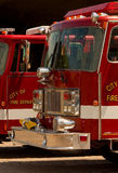 Fire trucks. Closeup view of sections of two city fire department trucks Royalty Free Stock Image