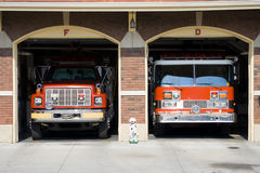 Fire trucks. Two fire trucks in the bays at the fire station Stock Photo