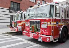 9/11 Fire Trucks. The Engine 205 Hook and Ladder 118 station in Brooklyn Heights responded to the nearby fires at the World Trade Center on 9/11/01. Eight Stock Photos