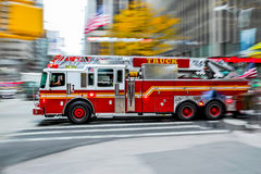 Fire trucks and firefighters brigade in the city Royalty Free Stock Images