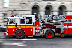 Fire trucks and firefighters brigade in the city Stock Photos