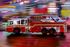 Fire trucks and firefighters brigade in the night city Stock Image