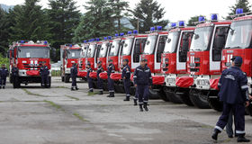 Fire trucks and firefighters Stock Image
