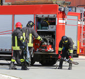 Fire trucks and firefighters with uniforms and protective helmet Stock Photography