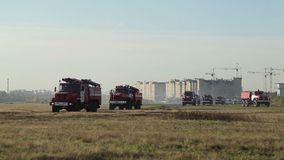 Fire trucks going to the challenge stock footage