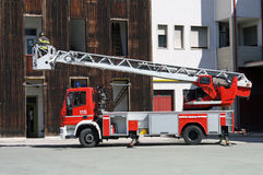 Fire trucks ladder truck during a rescue mission. Italian fire trucks ladder truck during a rescue mission Stock Image