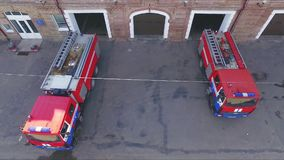 Fire trucks leave the fire station stock video footage