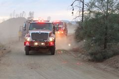 Fire trucks. Making their way through wildfire in Northern California Royalty Free Stock Photo