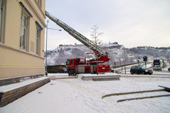 Fire trucks on a mission. Halden fire department dismantle the Christmas lighting in the pedestrian street in Halden Royalty Free Stock Photo